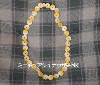丸モチーフのネックレス